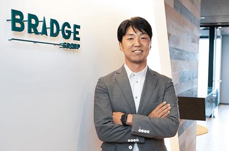 ブリッジインターナショナル株式会社様 動画を再生